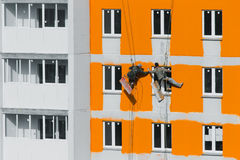 House painters. Paint the facade of building Stock Photos