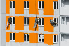 House painters. Paint the facade of building Stock Images