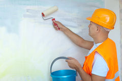 House painters with paint roller. Male house painters with paint roller in new house Royalty Free Stock Photo