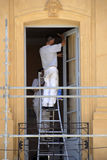 House painters at work. Two professional house painters at work Royalty Free Stock Photos