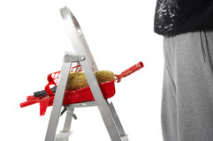 House painting. Painter, ladder and painting tools Royalty Free Stock Photos
