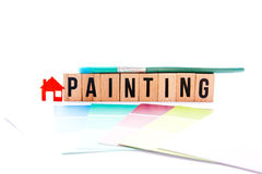 House Painting. Blocks, brush and swatches on white background Royalty Free Stock Photography