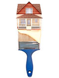 House painting concept. House on top of a blue paintbrush with paint dripping down Royalty Free Stock Images