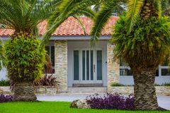 House with palm trees upscale mansion Royalty Free Stock Photos