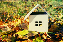 House from paper in bright yellow autumn leaves. Royalty Free Stock Photography