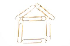 House from paper clips on the white isolated backg Stock Image