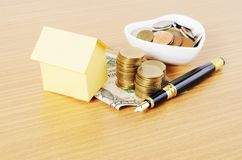 House paper and Fountain pen with money coins stack on wooden de Stock Photo