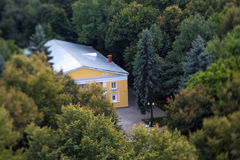 A house in the park (tilt-shift). A house in the Izmailovo Park (Moscow, Russia). photographed from the Ferris wheel with tilt-shift lenses Stock Photos