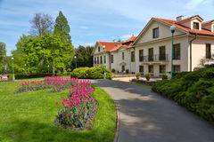 House in a park with tulips Stock Images