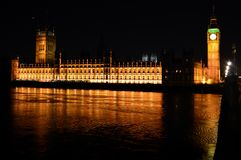 House of parliament. London, the illuminated House of Parliament and the Big Ben get reflected in the water of the river Thames. Replacing the old parlament that Royalty Free Stock Photos