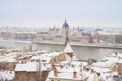 House of  parliament, Budapest, Hungary. House of parliament over snowed roofs of Buda hill, Budapest, Hungary Royalty Free Stock Images