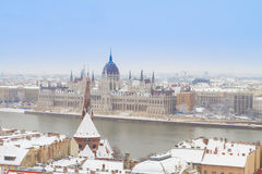 House of  parliament, Budapest, Hungary. House of parliament over snowed roofs of Buda hill at winter day, Budapest, Hungary Royalty Free Stock Images