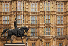 House of Parliament in London. The buildings of the House of Parliament with a statue of Richard Stock Photo