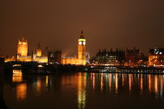 House of Parliament at night. A view across the Thames River in London to the British House of Parliament and Big Ben Tower at night Stock Photos