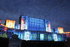 House of Parliament - night, Bucharest, Romania. House of Parliament night at Bucharest, Romania - facade to Constitution Square projection lights in celebration royalty free stock photo