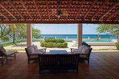 House patio on beach. Side with swimmong pool stock image