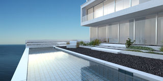 House with patio and pool overlooking the sea Royalty Free Stock Photography
