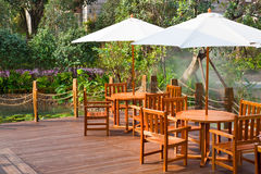 House patio with table and chairs. Under umbrella stock images