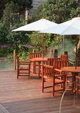House patio with table and chairs. Under umbrella stock image