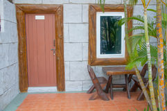 House patio with wooden table. And chairs stock images