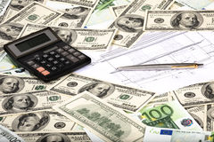 House payments calculation. Building plan and paper money Stock Photography