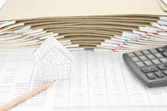 House and pencil with calculator have envelope between paperwork Royalty Free Stock Photos