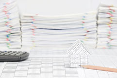 House with pencil have blur calculator and paperwork as background Royalty Free Stock Photography
