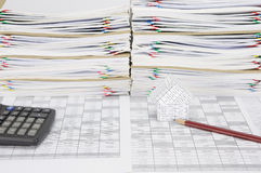House with pencil have overload paperwork with envelope as background Stock Photos