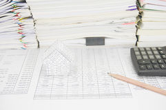 House and pencil have paperwork with books as background Stock Photos