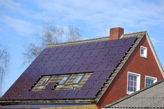 House with photovoltaic system. House with purple solar panels, extremely rarely Royalty Free Stock Photos