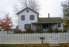 House with picket fence in Sauder Farm and Craft Village, OH Stock Photo