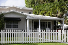 House with a picket fence Stock Photos