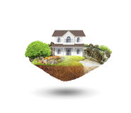 House on a piece of earth. With garden Royalty Free Stock Images