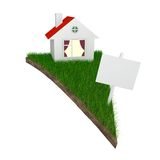 House on piece of land with grass Stock Image