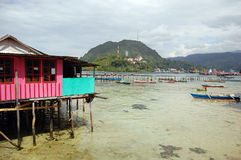 House and pier at sea coast. Jayapura, Indonesia Royalty Free Stock Photo
