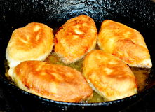 House pies. Are fried on sunflower oil Royalty Free Stock Image