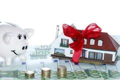 House and piggy bank Stock Photos
