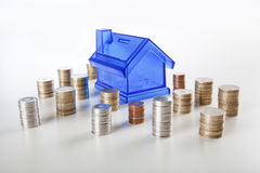 House piggy bank and coin Stock Photo