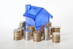 House piggy bank and coin Royalty Free Stock Photos