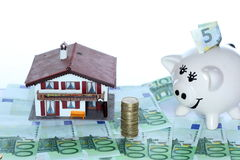 House and piggy-bank with money Royalty Free Stock Image