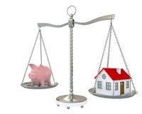 House and piggy bank on the scale Stock Image
