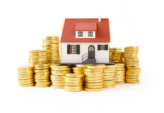 House on pile of gold coins Royalty Free Stock Images