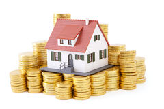 House on pile of gold coins Stock Photos