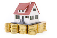 House on pile of gold coins Stock Image