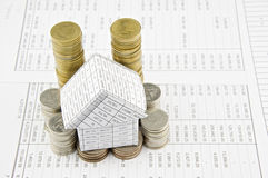 House on pile gold and silver coins with finance Stock Photography