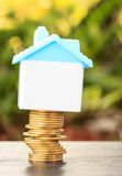 House on a pile of money Royalty Free Stock Photos