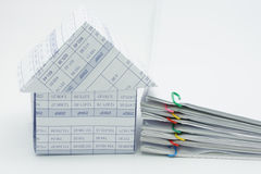 House and pile overload document. With colorful paperclip on white background royalty free stock photography