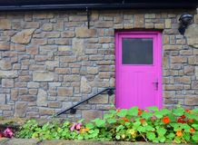 A house with a pink door in Mountshannon, County Clare, Ireland stock photography