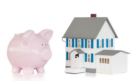 House and pink piggy bank Stock Photo