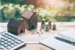 House placed on coins Men`s hand is planning savings money of coins to buy a home royalty free stock images